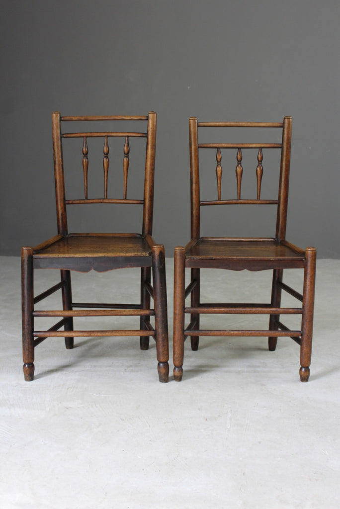 pair country made vernacular chairs