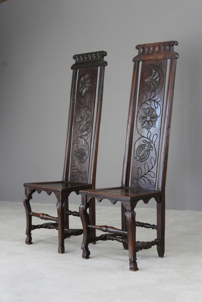 pair carved oak high back chairs