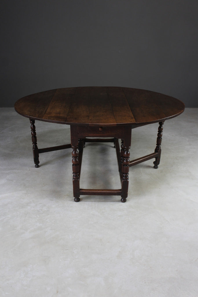 Antique Oak Oval Drop Leaf Dining Table - Kernow Furniture