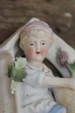 German Bisque Porcelain Hanging Figure.