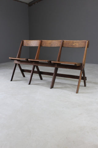 bank of three oak folding chairs seats