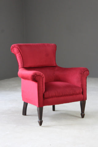 red upholstered antique victorian armchair chair