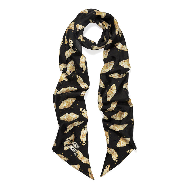 Ebony Moth black skinny silk scarf in a cream and gold moth print by Louise Coleman