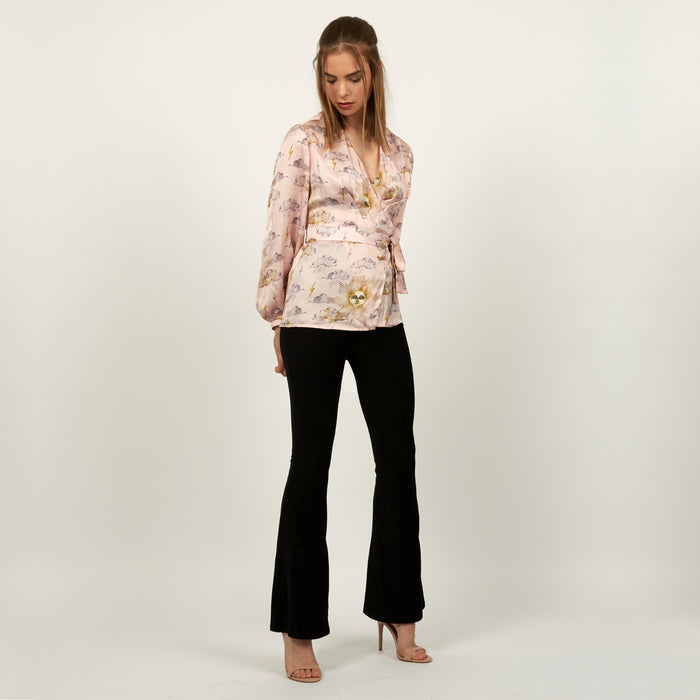 Wrap top in pale pink Sun Man print by Louise Coleman