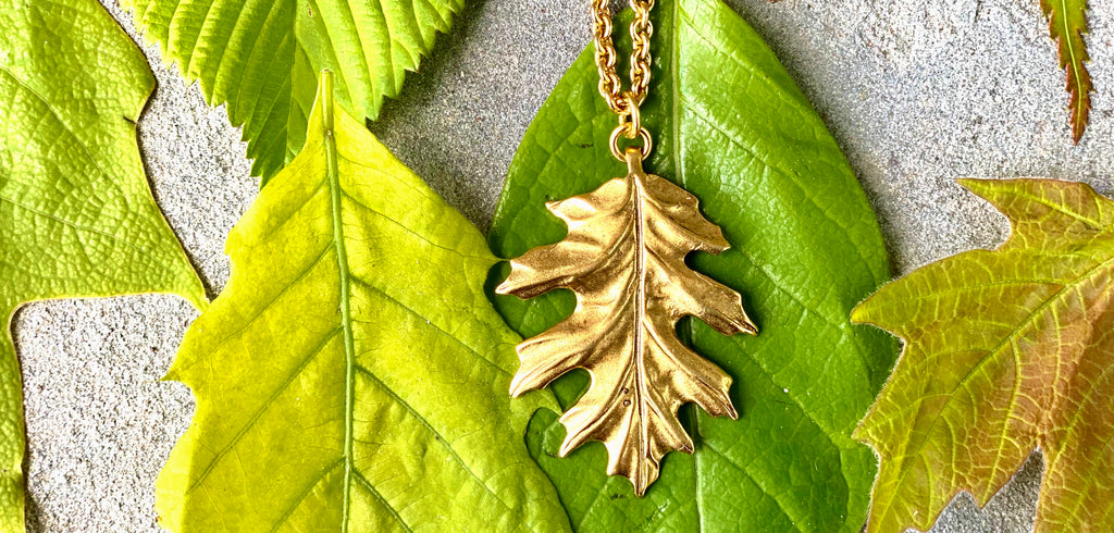oak leaf necklace with a matte gold finish