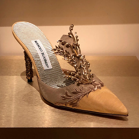 Manolo Blahnik elegant backless shoe with golden thread embroidery.