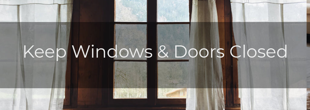 Keep Windows and Doors Closed - Image of large windows with sheer curtains