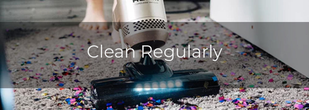 Clean Regularly- Image of a person with a vacuum cleaning confetti off of a carpet
