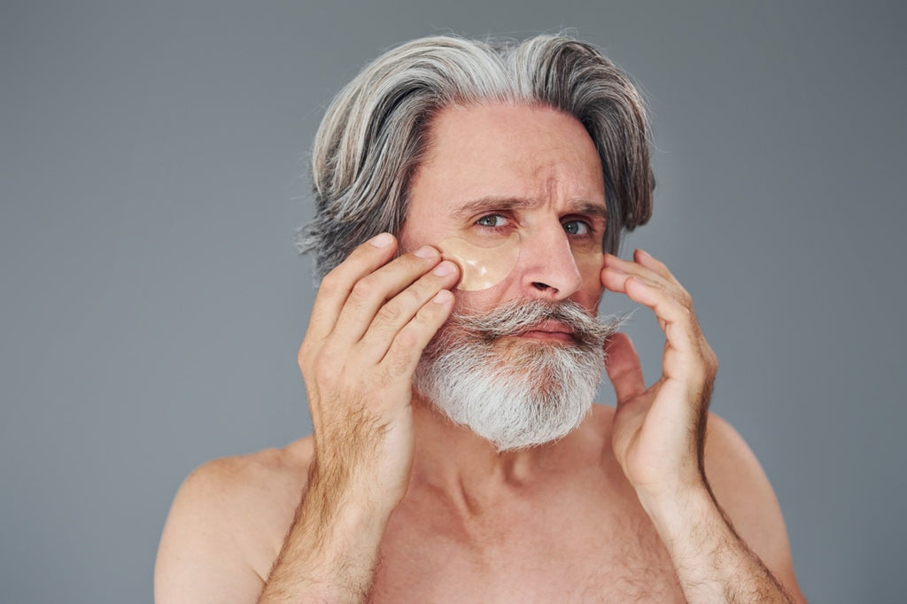 Bearded man cleaning his face