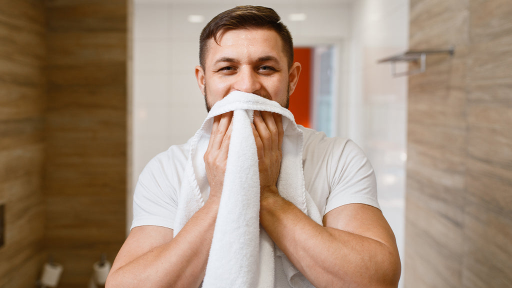 Beard being towel dried after washing
