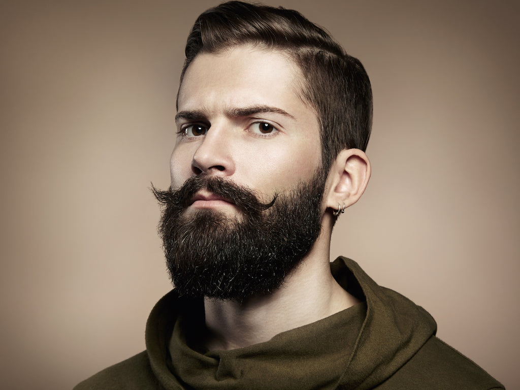 Well maintained and styled beard with curled mustache