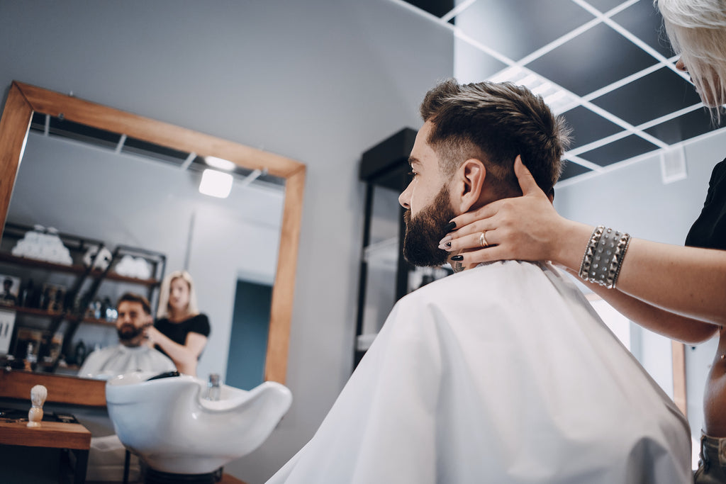 Man about to get his beard trimmed after wearing a mask