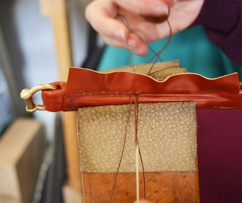 Hand stitching our handles