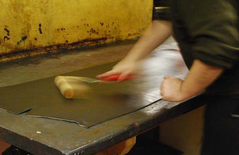 Michael hand feeds tallow to our English Bridle Hides