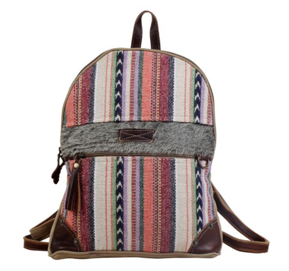 Upcycled backpack with an artistic design, borrowed from a unique handwoven rug.