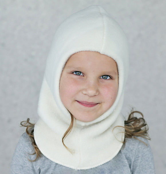 11 yr old girl wearing off-white wool balaclava