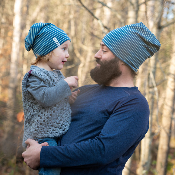 Young girl wearing a white balaclava hat