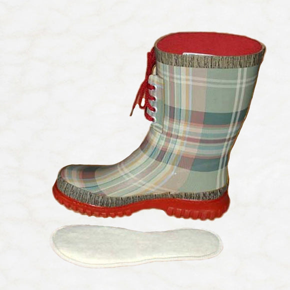 Children's rainboot with wool insole lying next to it.
