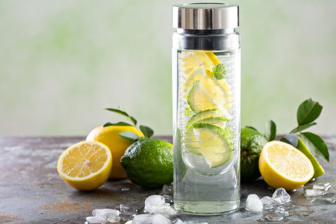 Water bottle with water infused with lemon and limes