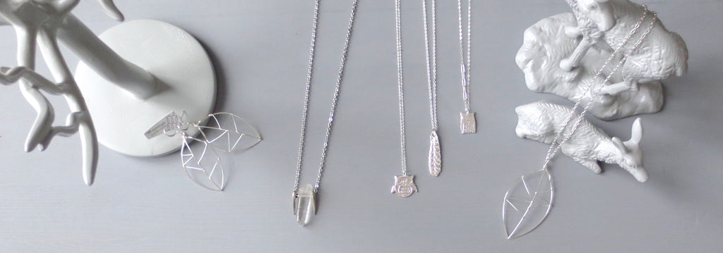 InfinEight Jewelry organic motif necklaces: leaf earrings, long silver crystal necklace, owl necklaces, feather necklace, leaf necklace