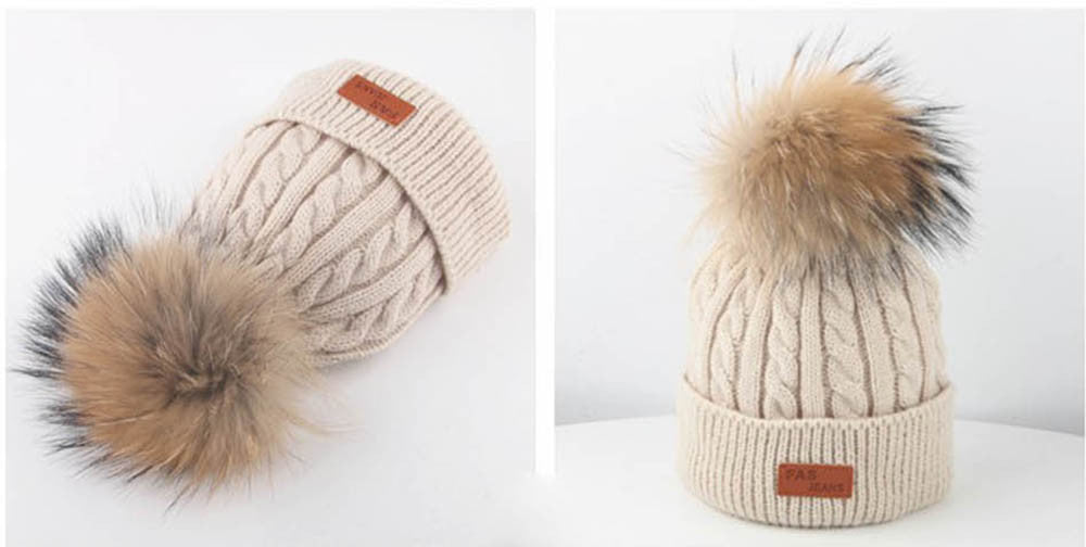 Ivory Knit Hat With Pom-Pom by SCOUTED.
