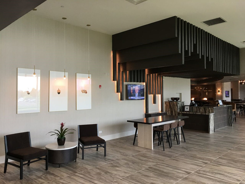 Custom Faux Wood Panels Disguise Soffits in Modern Hotel Renovation
