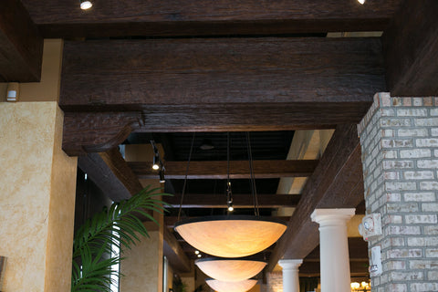 Commercial Space Transformation with Faux Wood Beams: Dark beams establish cozy, tranquil atmosphere