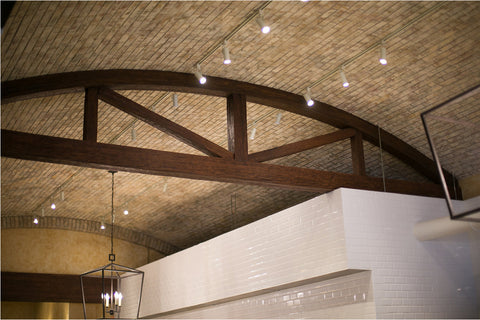 Commercial Space Transformation with Faux Wood Beams: Sophisticated Rustic Feel