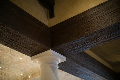Commercial Space Transformation with Faux Wood Beams: Dark Color and Rich Texture