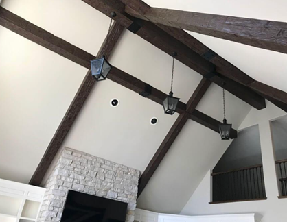 widely spaced faux wood beams in a living room
