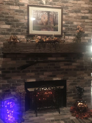 a faux brick fireplace with traditional brick panels