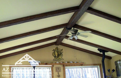 faux reclaimed wood beams installed on living room ceiling