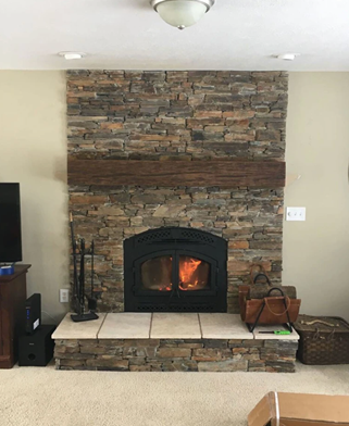 faux reclaimed wood beam fireplace mantle