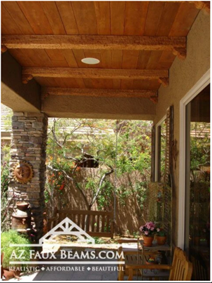 faux reclaimed wood beams installed as panels on the ceiling of an outdoor patio