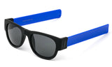 Trendy Folding Horned Rim Sunglasses with Colored Rubber Bendable Temples in Black and Blue.