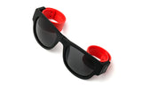 Trendy Folding Horned Rim Sunglasses with Colored Rubber Bendable Temples in Black and Red.