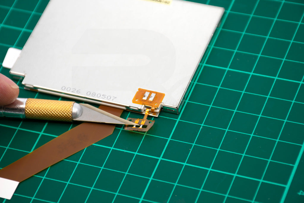 Prepare AGS-101 LCD by separating top ribbon from the one below