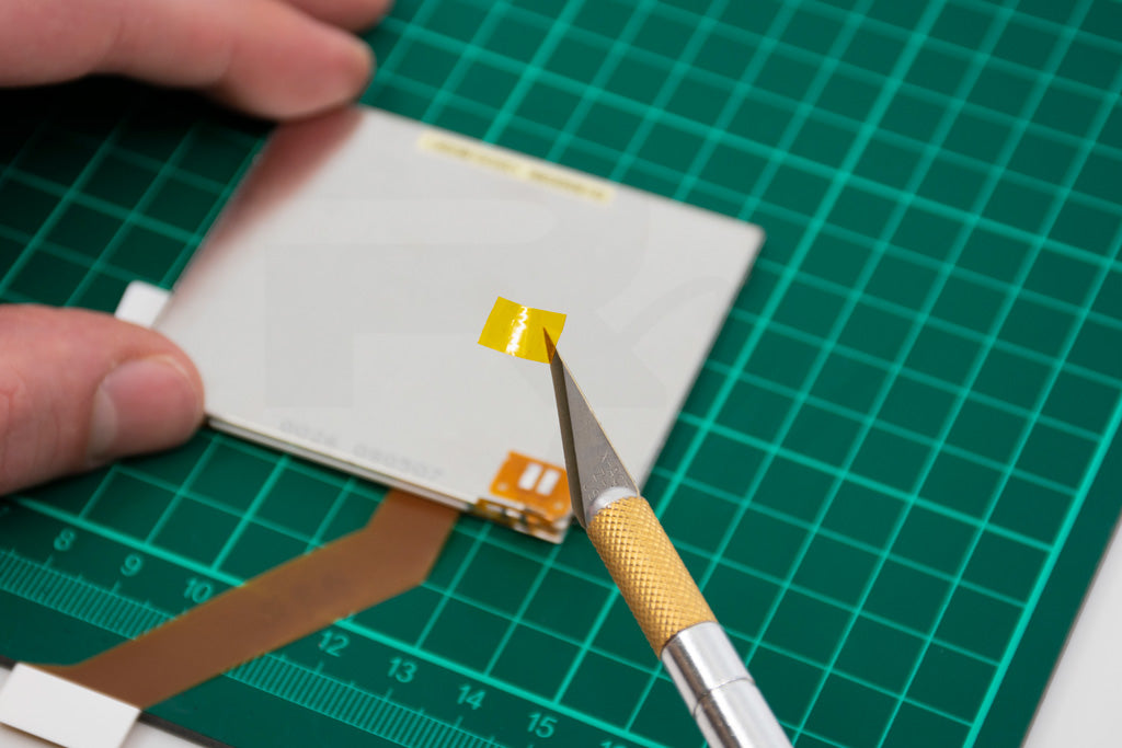 Apply a small piece of Kapton tape over the bottom ribbon