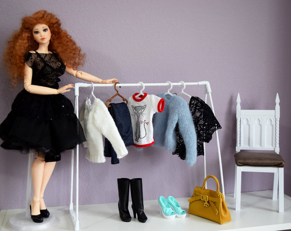1/4 MSD size doll clothing rack with two hangers
