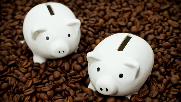 coffee beans and piggy banks