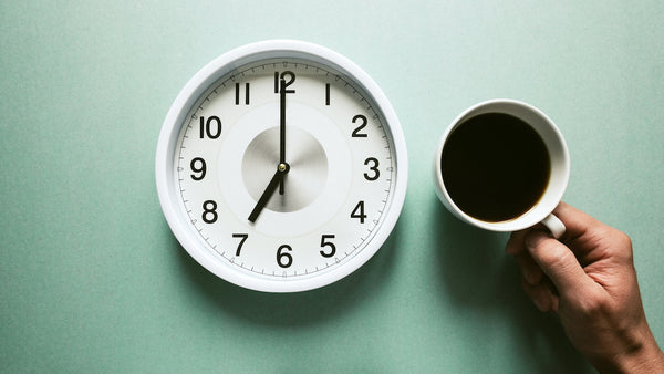 a clock and a cup of coffee