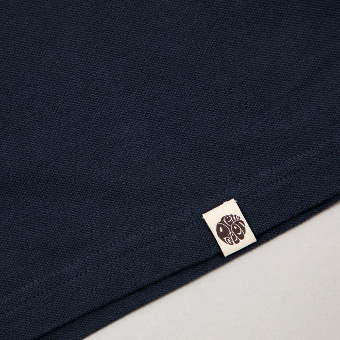 Likeminded Chest Badge Polo Shirt in NAVYPRETTY GREEN - CACTWS