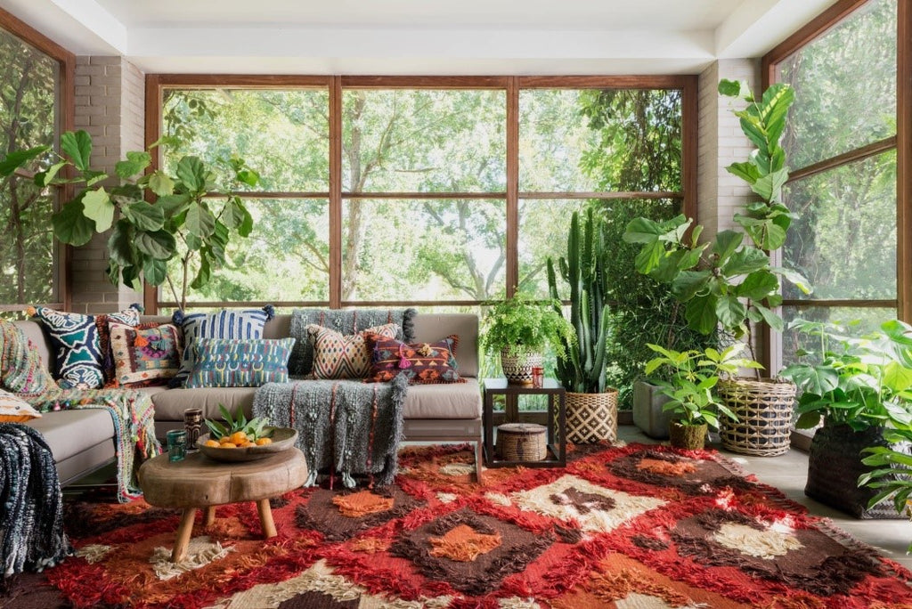 boho living room with plants and textures