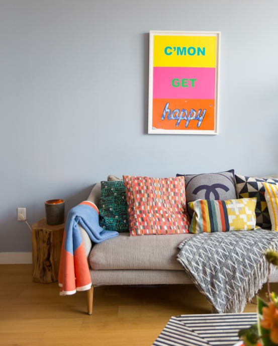 bright cheerful poster with colorful scatters on gray sofa