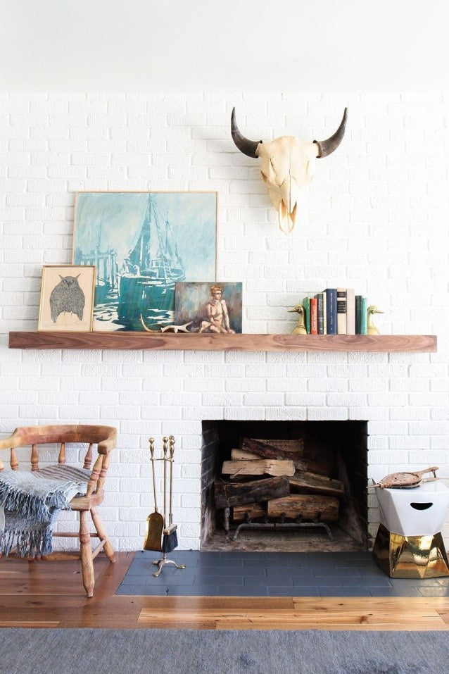 skull and prints over fireplace