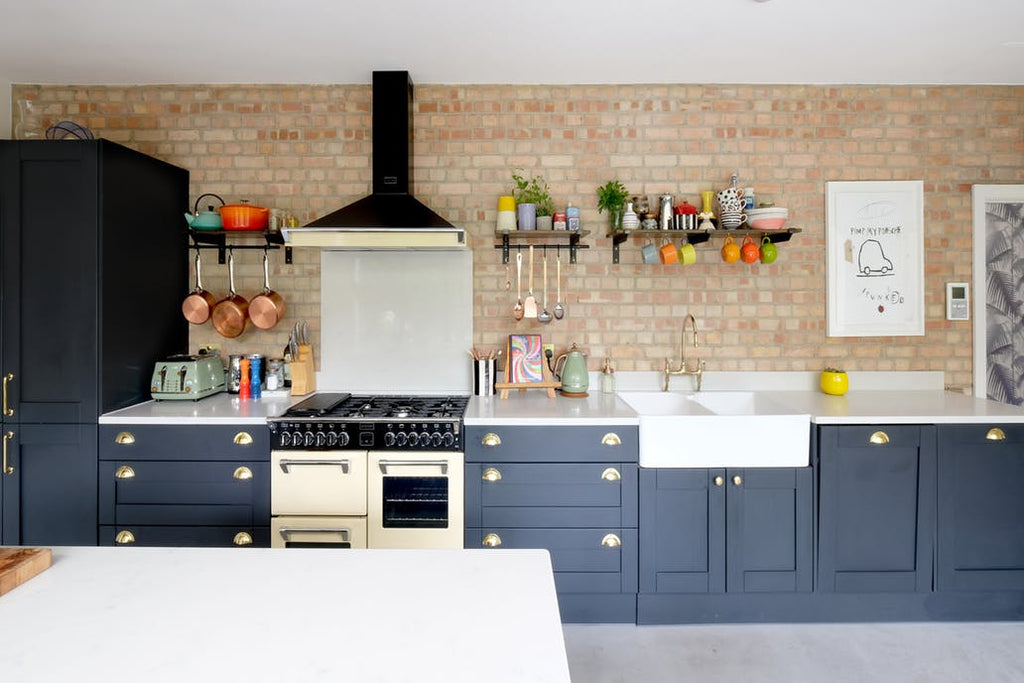 kitchen blue cabinets brick wall