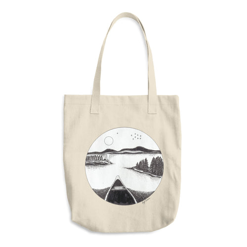 Beige tote bag with circular print of a canoe on a still moonlight lake, black and white.