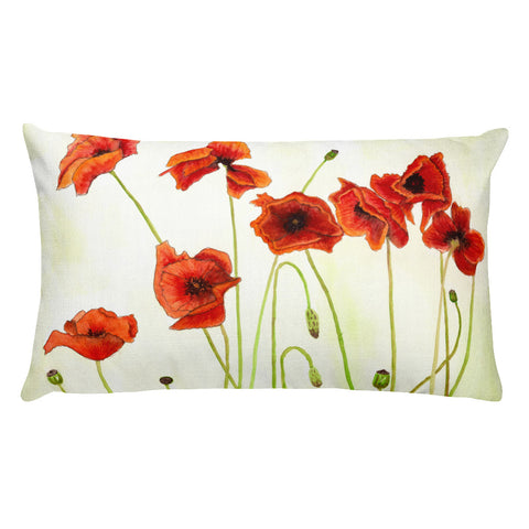 White background pillow with large bright red poppies and green stems.
