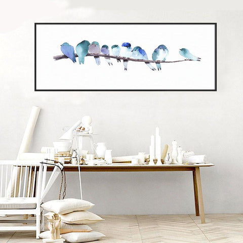 Blue and purple shades of little watercolor birds on branch.