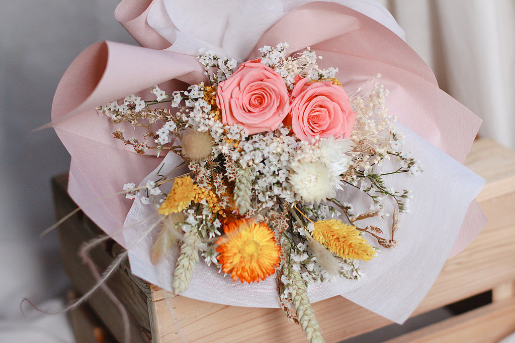dried pink yellow roses bouquet